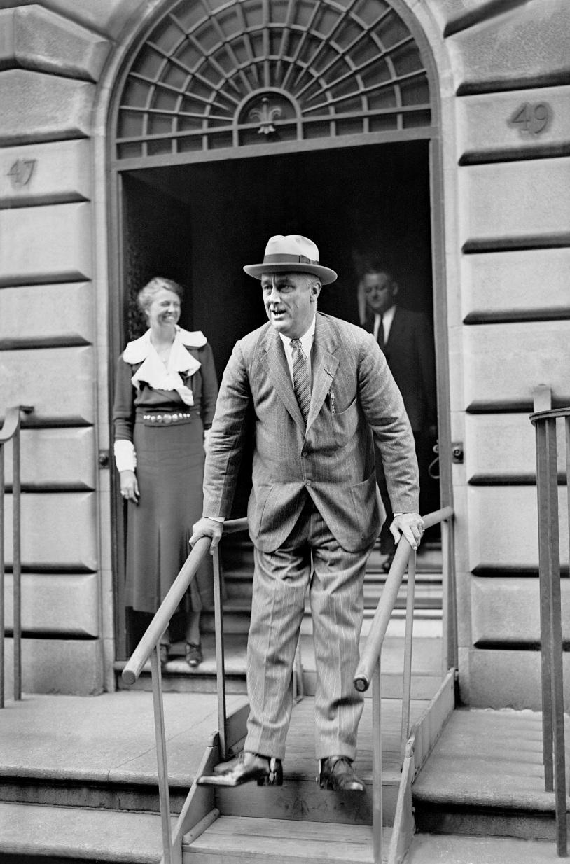 President Franklin D. Roosevelt leaves his home at 49 East 65th Street for a short visit to his family estate at Hyde Park, north of New York City on Sept. 27, 1933.