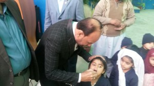 DG Saleem Rao administrating polio drops to the child
